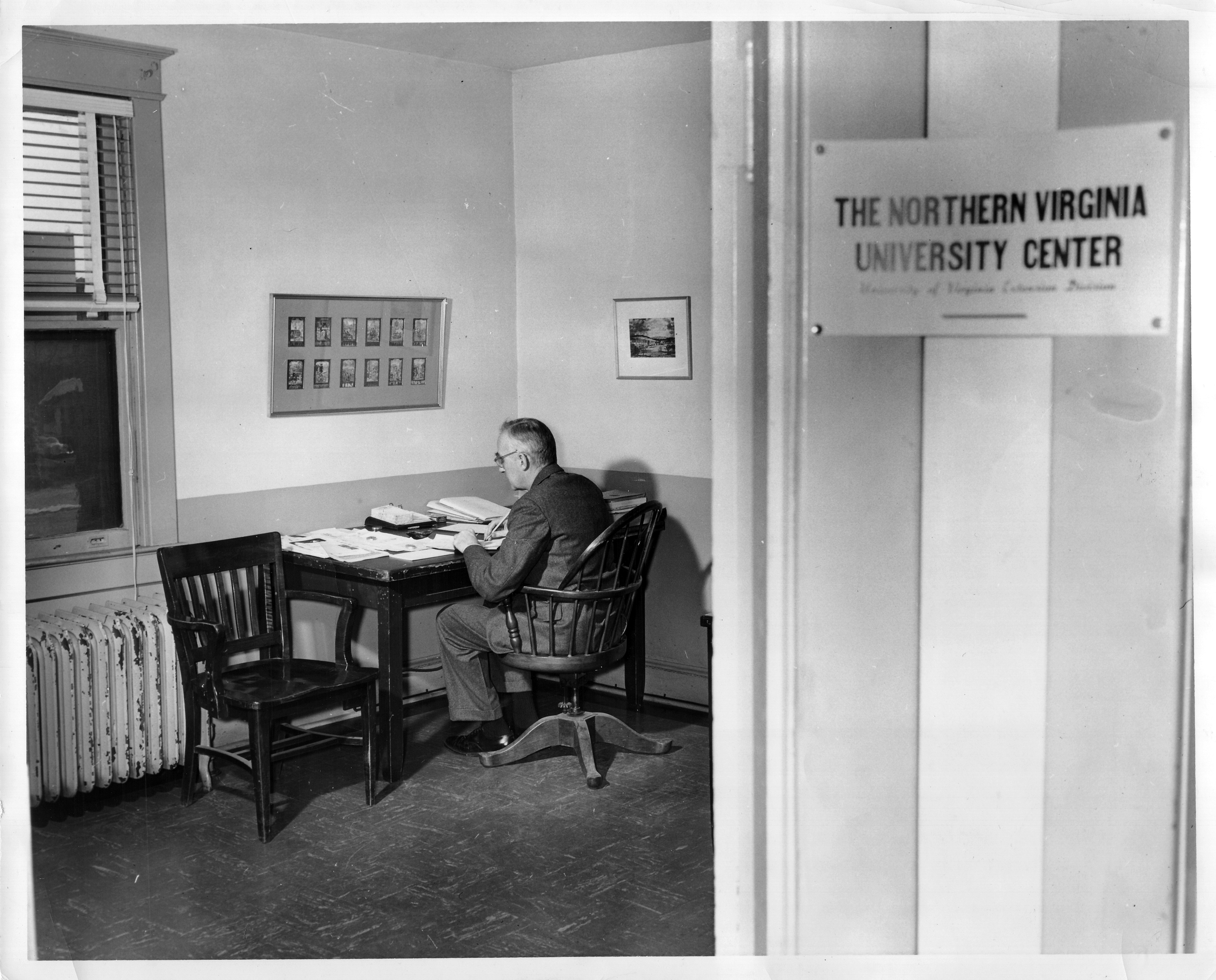 John Norville Gibson Finley at his desk, Northern Virginia University Center, December 22, 1953.