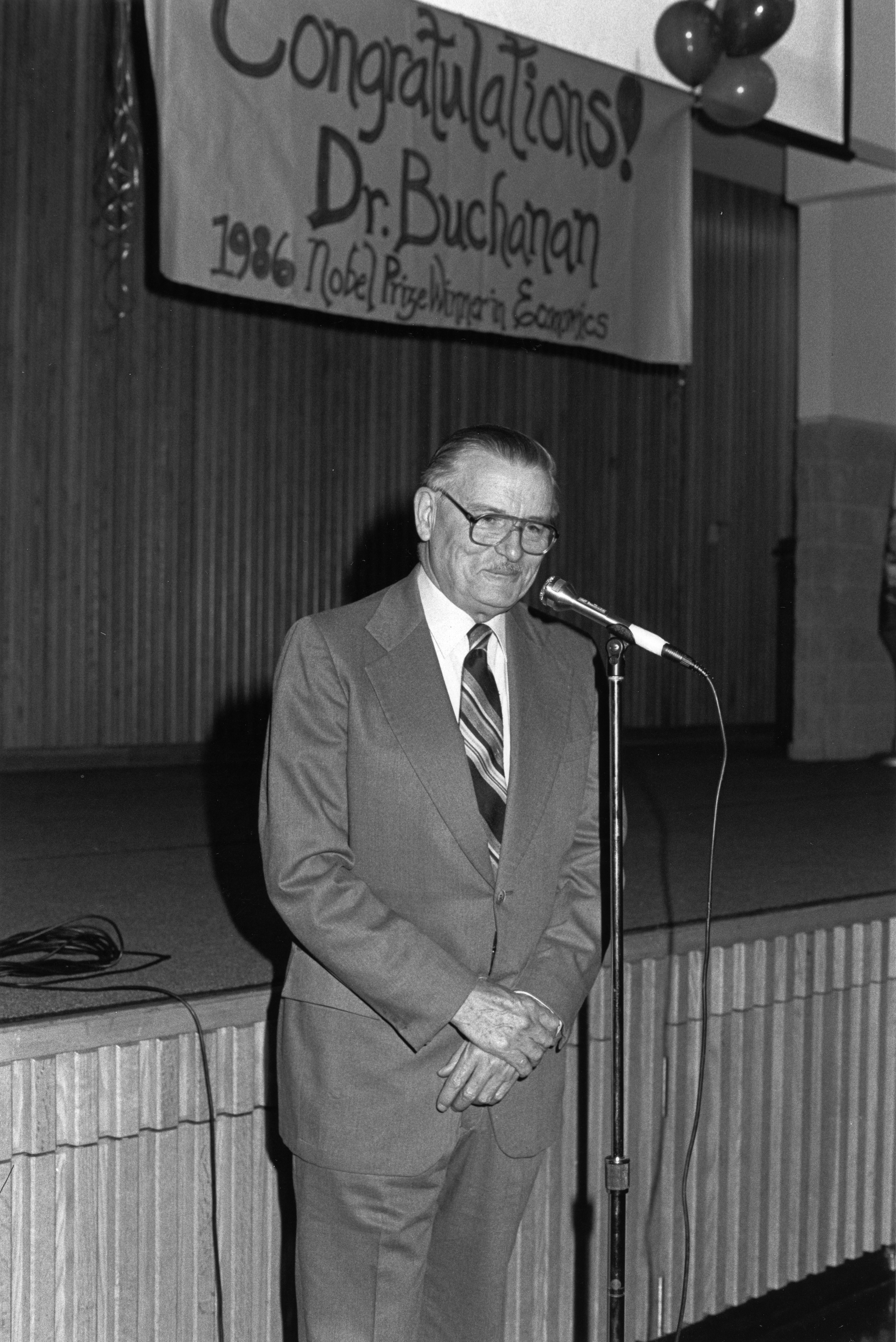 George Mason University Nobel laureate James M. Buchanan speaks at a reception in his honor, October 1986.