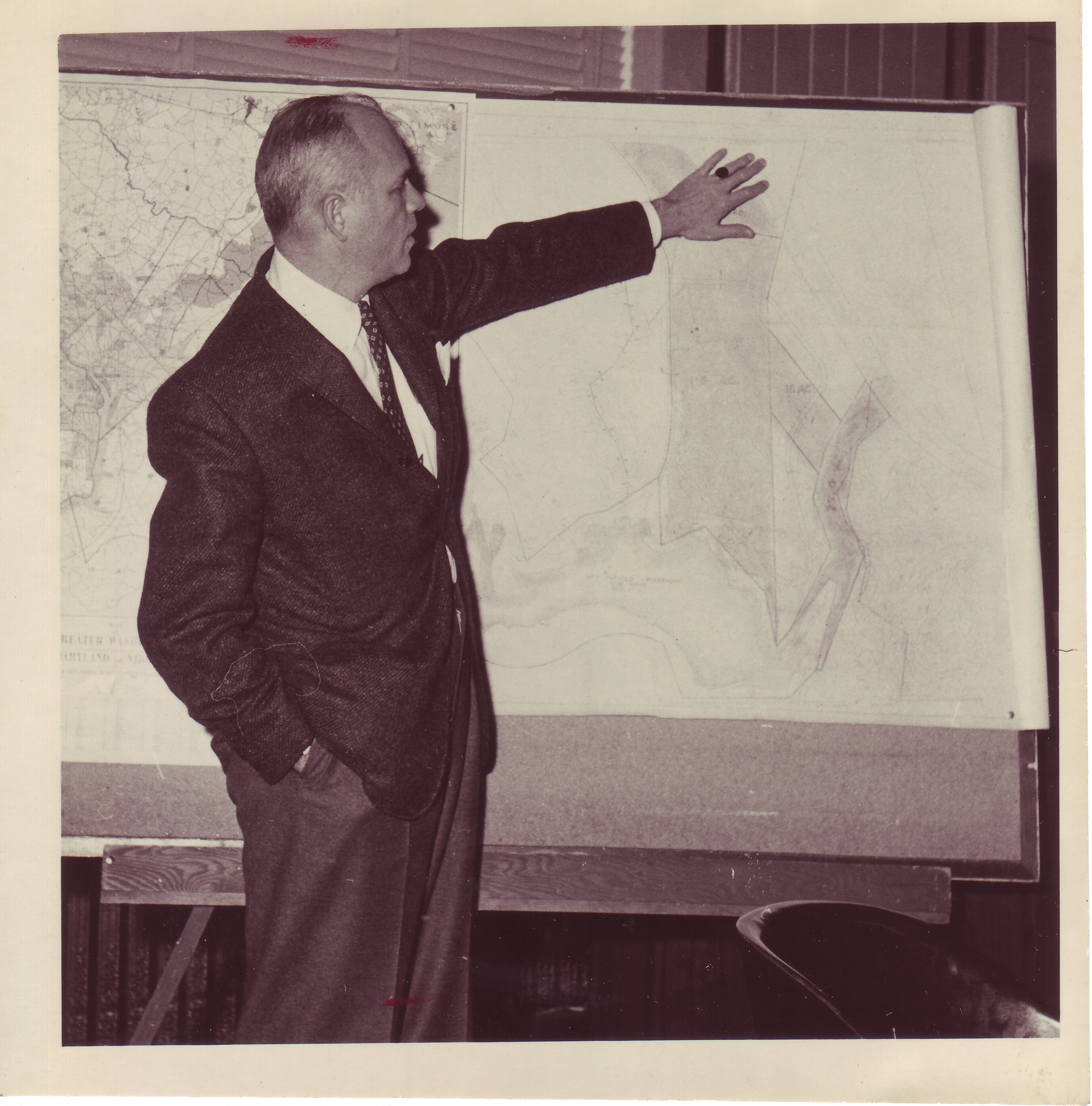 C. Harrison Mann, Jr. displaying plat depicting the Ravensworth property, ca. 1957