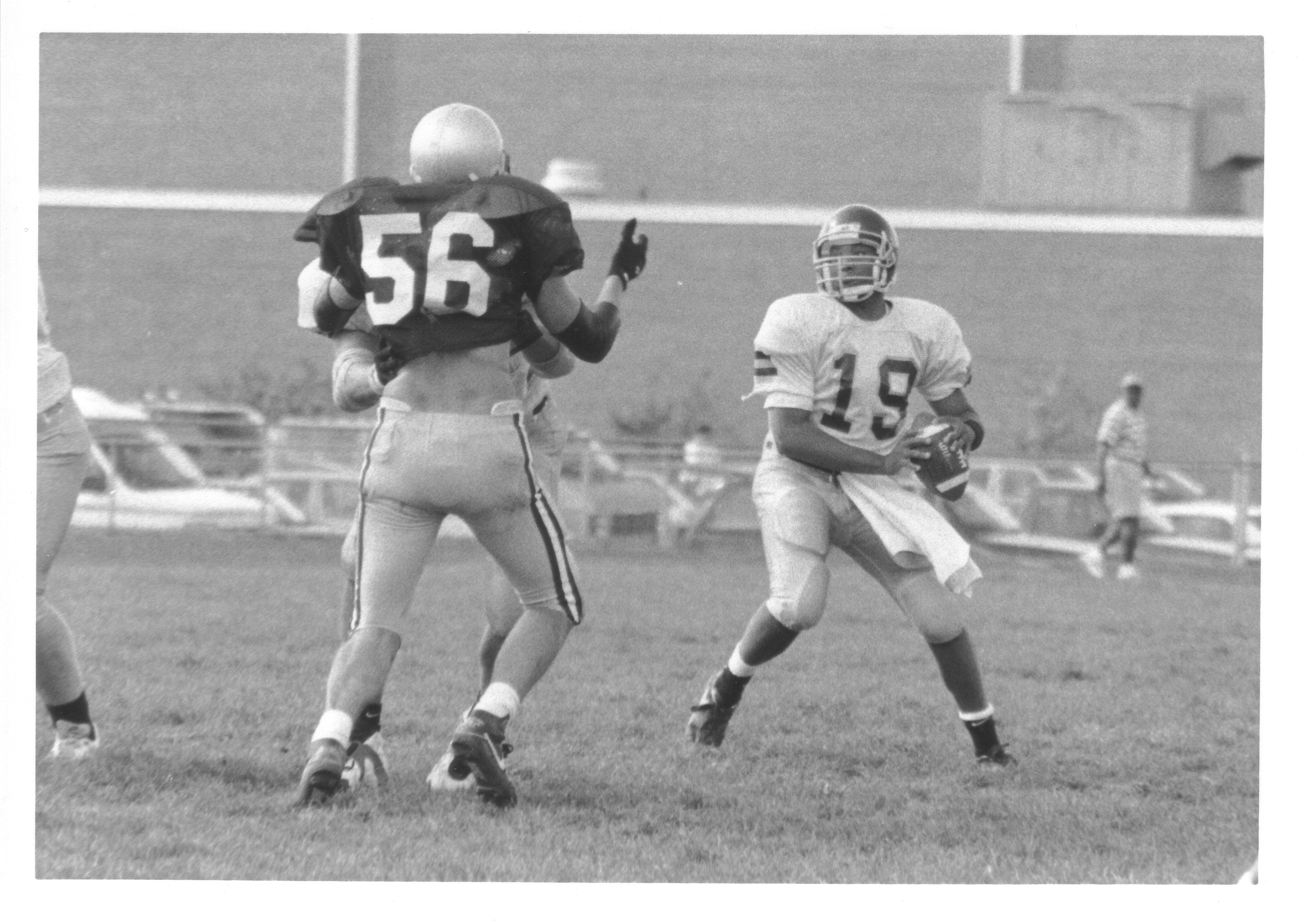 George Mason University quarterback Earl Jackson in action against an unidentified opponent, September 30, 1995