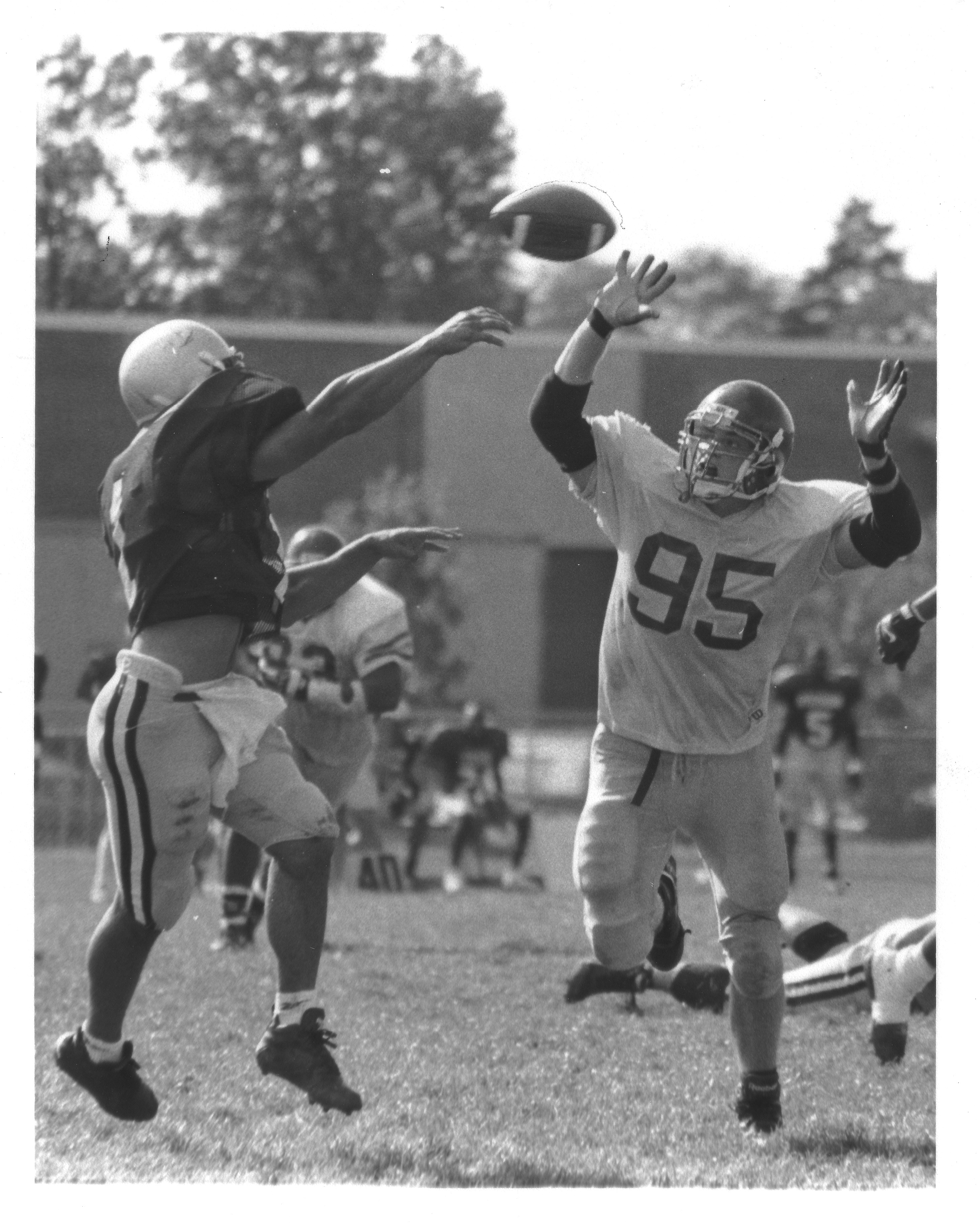 George Mason University football player in action against an unidentified opponent, September 30, 1995