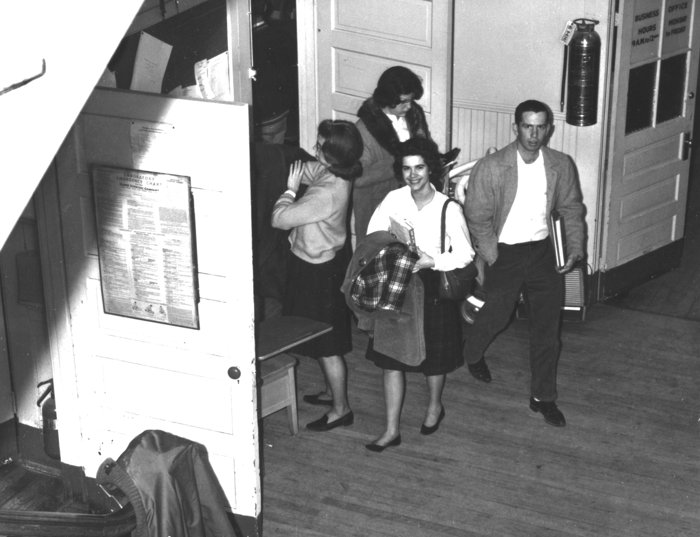 Marianne Torregrossa, Kathy Parnell, Anne Walker, [and] Jim Pracht getting out of 5 o'clock math class, Bailey's Crossroads.