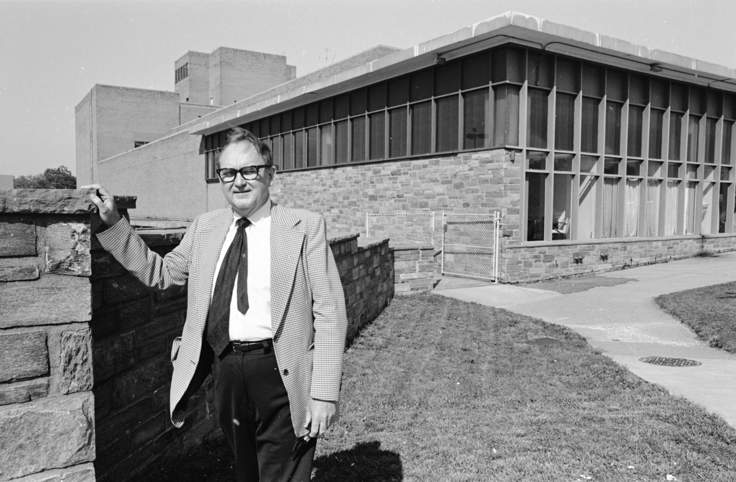 George Mason University School of Law Dean, Ralph N. Norvell in front of the School of Law building